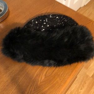Black knit faux fur hat. One size fits all